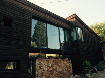Villa en bois avec chassis coulissant